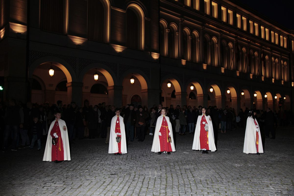 Young cofrades from the Cofradia Penitencial Santísimo Cristo Despojado  in front of the Calderón Theater. General Procession of Holy Friday